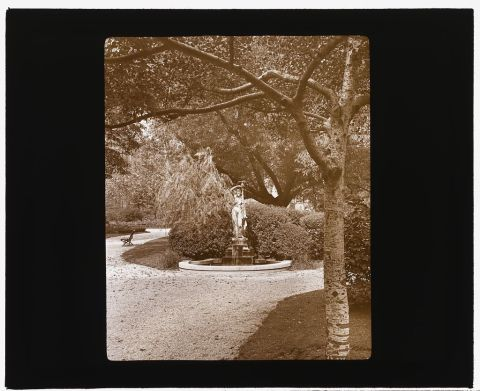Title: [Gramercy Park, between East 20th and East 21st Streets east of Park Avenue, New York, New York. Fountain] Related Names:     Johnston, Frances Benjamin, 1864-1952 , lecturer Date Created/Published: [ca. 1922] Medium: 1 photograph : glass lantern slide, sepia toned ; 3.25 x 4 in. Call Number: LC-J717-X98- 78 [P&P]