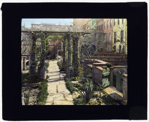 Title: [Turtle Bay Gardens, 227-247 East 48th Street and 228-246 East 49th Street, New York, New York. Pergola in common garden] Creator(s): Johnston, Frances Benjamin, 1864-1952, photographer Date Created/Published: [1920 Fall] Medium: 1 photograph : glass lantern slide, hand-colored ; 3.25 x 4 in. Call Number: LC-J717-X107- 17 [P&P]